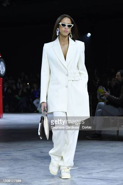 Noemie Lenoir walks the runway during the Off-White show as part of the Paris Fashion Week Womenswear Fall/Winter 2020/2021 on February 27, 2020 in...