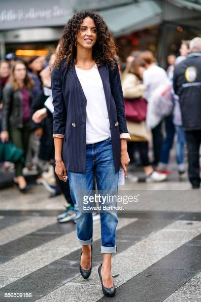 Noemie Lenoir wears a striped blazer jacket a white top cropped jeans and attends Le Defile L'Oreal Paris as part of Paris Fashion Week Womenswear...