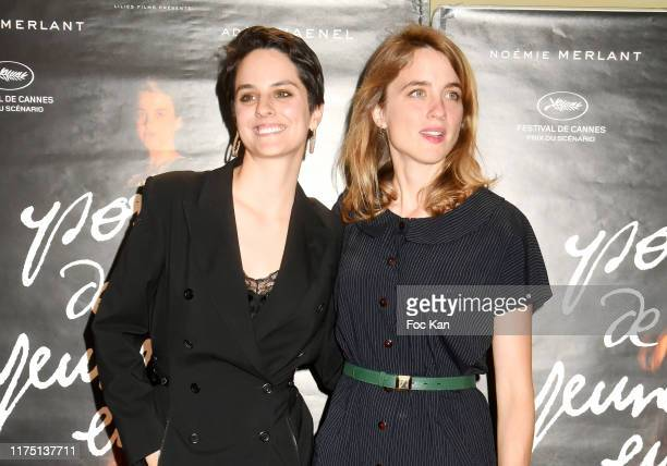 Noemie Merlant and Adele Haenel attend the Portrait De La Jeune Fille en Feu Paris premiere at UGC Cite Les Halles on September 16 2019 in Paris...