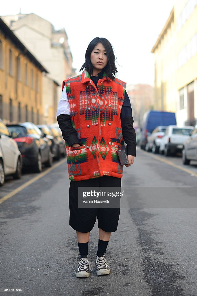 Noey Park poses wearing an El Charro top, Marni shirt and Converse shoes during day 2 of Milan Menswear Fashion Week Fall/Winter 2015/2016 on January 18, 2015 in Milan, Italy.
