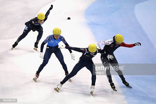 Noh Jinkyu of Korea Charles Hamelin of Canada Yuzo Takamido of Japan and Victor An of Russia rush to the finish line in the Men's 1500m Final during...