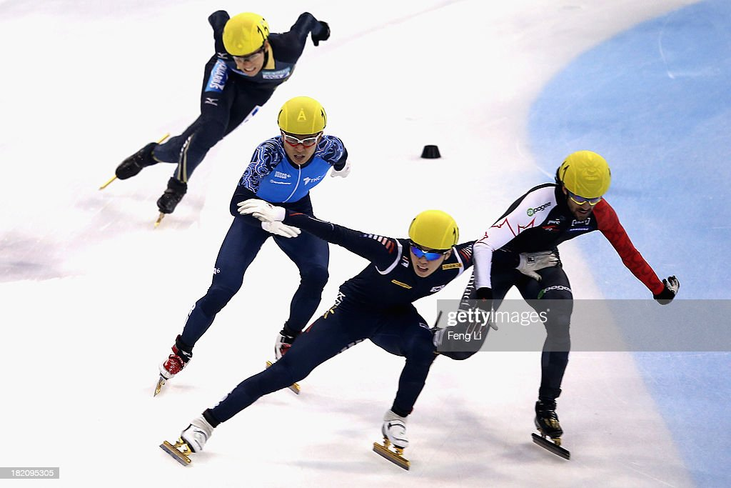 Noh Jinkyu of Korea (Front), Charles Hamelin of Canada (Right), Yuzo Takamido of Japan (Left) and Victor An of Russia (2nd Left) rush to the finish line in the Men's 1500m Final during day three of the Samsung ISU World Cup Short Track at the Oriental Sports Center on September 28, 2013 in Shanghai, China.