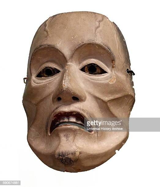 Noh mask of a ghost of a man living in the world of both the living and the dead Carved from blocks of Japanese cypress and painted with natural...
