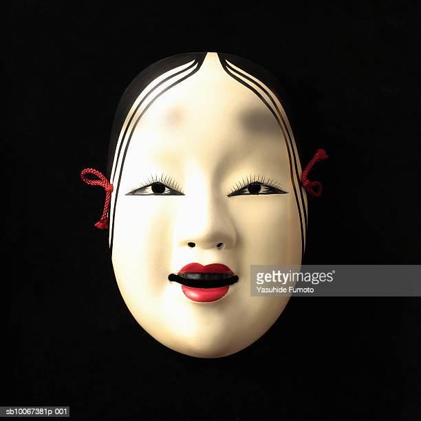 Noh mask on black background