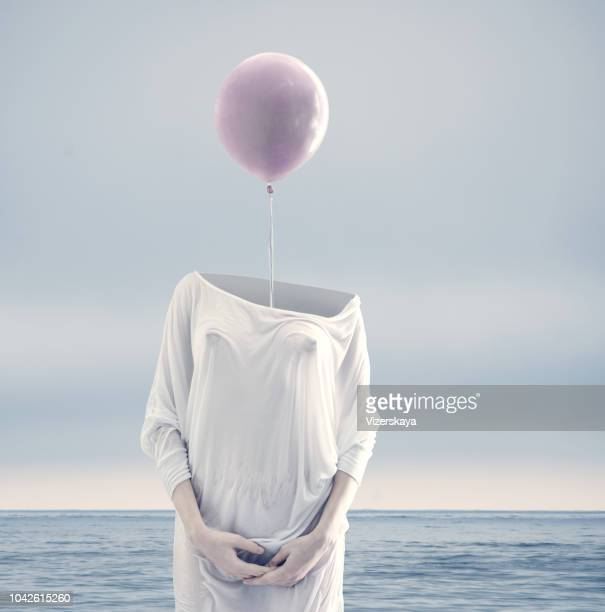 nohead women with lilac balloon - surreal stock pictures, royalty-free photos & images