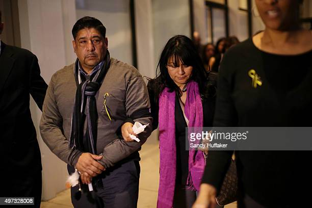 Nohemi Gonzalez's mother Beatrez Hernandez and stepfather JoseHernandez walk out after a vigil for Gonzalez who was killed during the attacks in...