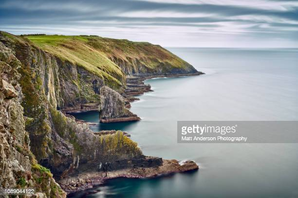 nohoval cove coastline long exposure - county cork stock pictures, royalty-free photos & images