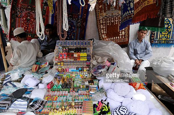 Religious things are displayed on the stall for sale outside a mosque at Sector 08 in Noida India on Wednesday July 10 2013 The first day of Ramadan...