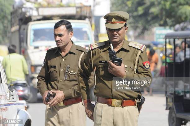 Noida police personnel on a flag march near Sector 30 Mosque on the day of the Supreme Court verdict in the Ram Janmabhoomi Babri Masjid case on...