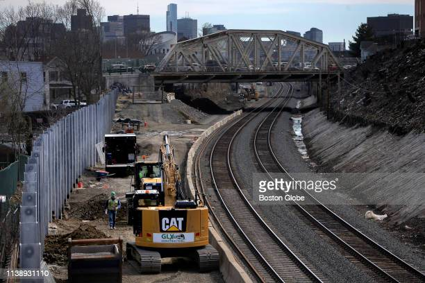 A noise barrier wall under construction near Walnut Street in Somerville MA is pictured on April 11 2019 Work has begun on extending the Green Line...