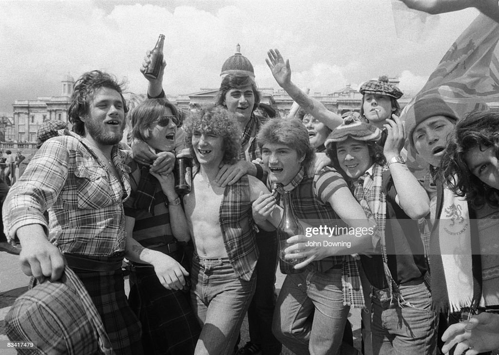 A noisy group of Scottish football fans in Trafalgar Square, circa 1980.