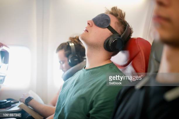 noisy snorer on a flight - uncomfortable stock pictures, royalty-free photos & images