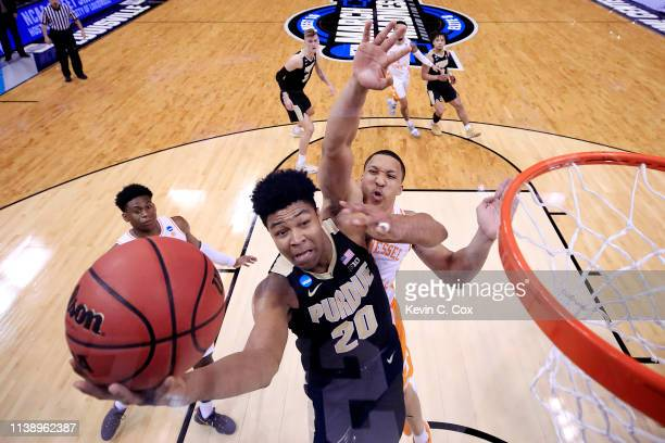 Nojel Eastern of the Purdue Boilermakers shoots over Grant Williams of the Tennessee Volunteers during the second half of the 2019 NCAA Men's...