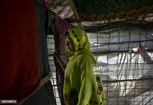 COX'S BAZAR BANGLADESH JANUARY 20 Nojiba is seen in her makeshift house that she shares with 14 other refugees on January 20 2017 in Kutalong...