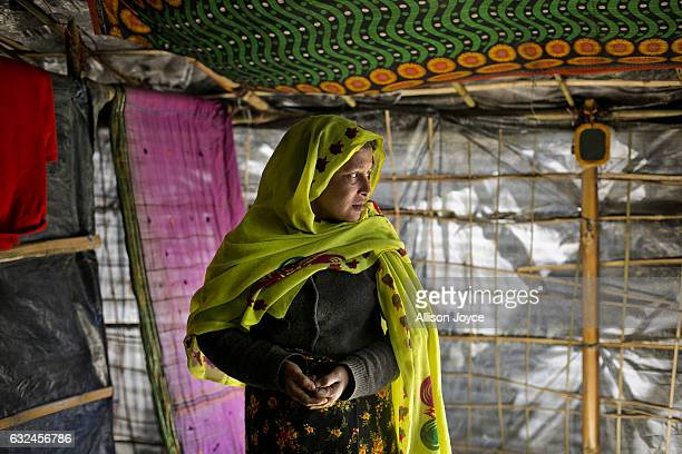 COX'S BAZAR BANGLADESH JANUARY 22 Nojiba is seen in her makeshift house that she shares with 14 other refugees on January 22 2017 in Kutalong...