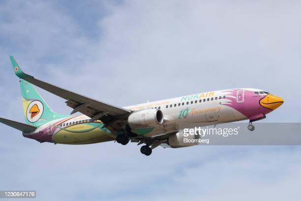 Nok Airlines Pcl aircraft prepares to land at Phuket International Airport in Phuket, Thailand, on Saturday, Dec. 19, 2020. The tepid response to...