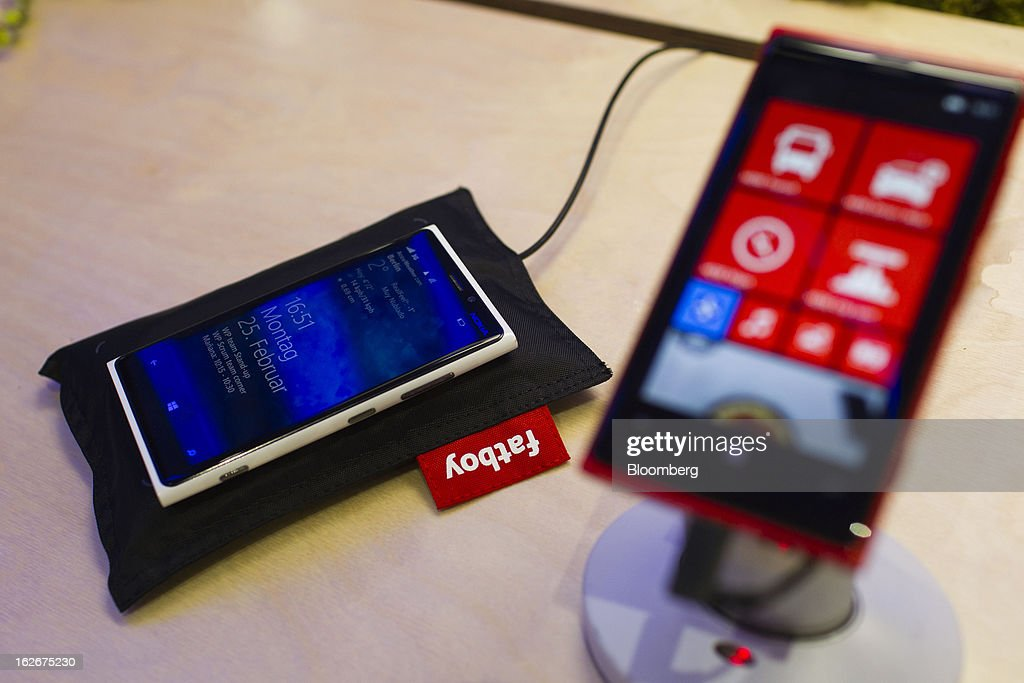 A Nokia 920 smartphone is seen beside a Nokia Fatboy wireless charger at the Mobile World Congress in Barcelona, Spain, on Monday, Feb. 25, 2013. The Mobile World Congress, where 1,500 exhibitors converge to discuss the future of wireless communication, is a global showcase for the mobile technology industry and runs from Feb. 25 through Feb. 28. Photographer: Angel Navarrete/Bloomberg via Getty Images