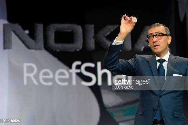 Nokia CEO Rajeev Suri presents a Nokia ReefShark Chipset during a press conference on February 25 2018 in Barcelona on the eve of the inauguration of...