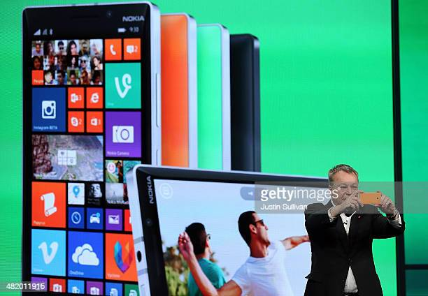 Nokia executive vice president Stephen Elop takes a picture using the new Nokia Lumia 930 smartphone as he speaks during a keynote address during the...