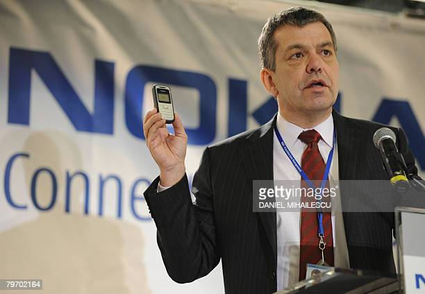 Nokia Senior Vice President Juha Putkiranta shows on February 11 2008 the first mobile telephone made in Romania at the Nokia factory in the village...