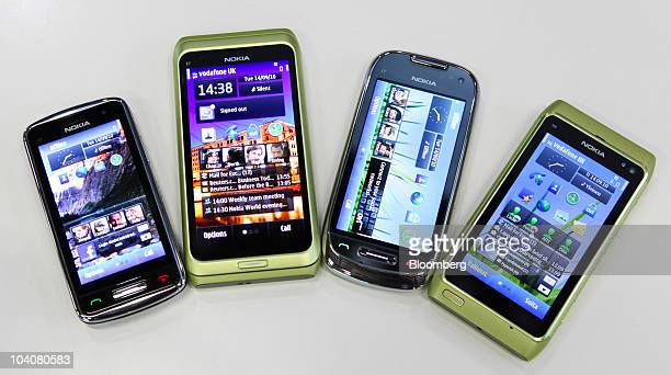 Nokia Symbian smartphones produced by Nokia Oyj left to right the C6 E7 C7 and N8 sit on display at the Nokia World event in London UK on Tuesday...