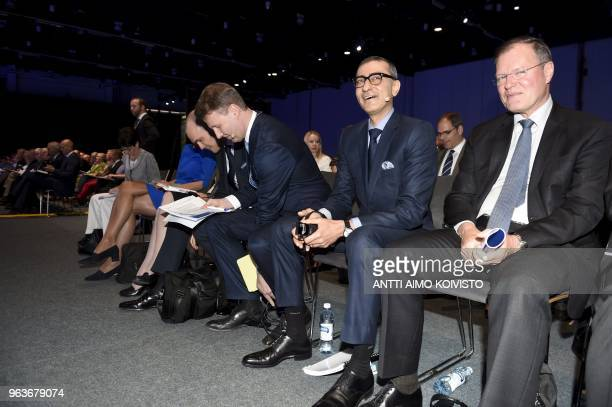 Nokia's Chief Financial Officer Kristian Pullola and Nokia's Chairman Risto Siilasmaa and CEO Rajeev Suri and Vice Chairman Olivier Piou attend the...