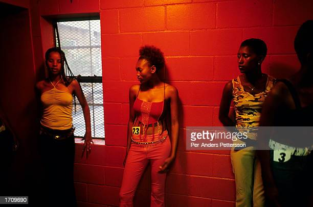 Nokybonga Maxhwee waits together with fellow women backstage during a Miss Khayelitsha contest on August 12, 2001 in Site C Khayelitsha, a township...
