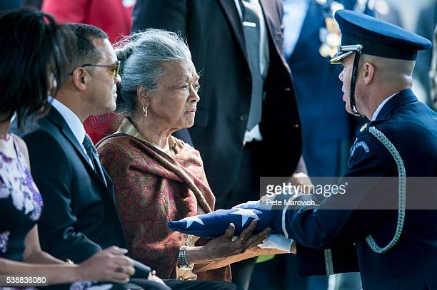 Nola Whitfield is presented the flag that covered the casket of her husband fivetime Olympian gold medalist and Tuskegee Airman 2nd Lt Malvin Greston...