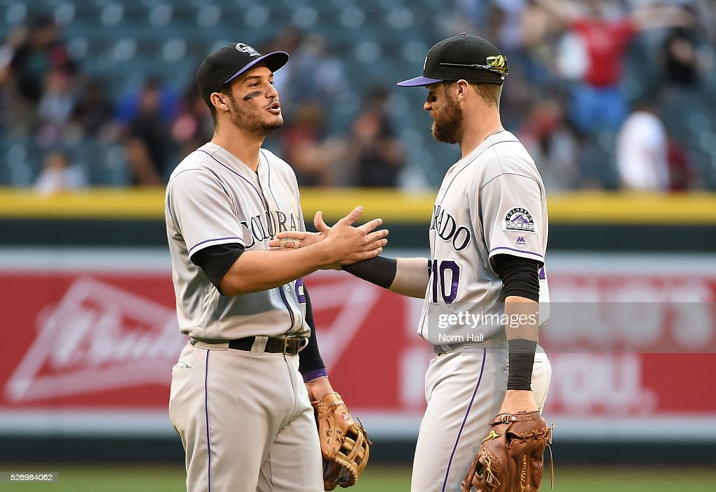 Nolan Arenado #28 and Ben Paulsen #10 of the Colorado Rockies celebrate a 6-3 win against the Arizona Diamondbacks at Chase Field on May 01, 2016 in Phoenix, Arizona.