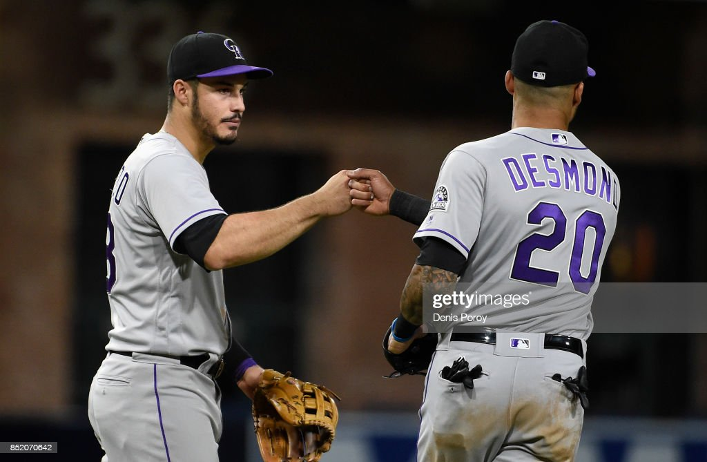 Nolan Arenado #28 of the Colorado Rockies and Ian Desmond #20 celebrate after beating the San Diego Padres 4-1 in a baseball game at PETCO Park on September 22, 2017 in San Diego, California.