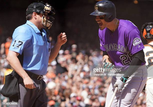 Nolan Arenado of the Colorado Rockies argues with home plate umpire D.J. Reyburn after Arenado was called out on strikes against the San Francisco...