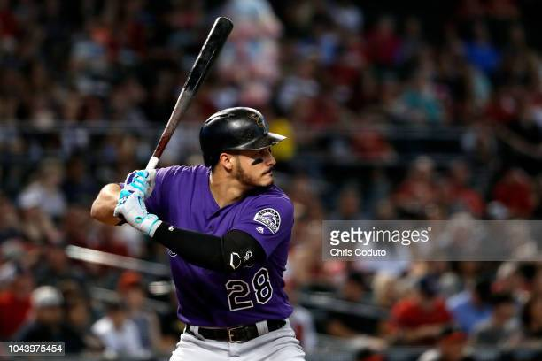Nolan Arenado of the Colorado Rockies bats during the top of the first inning at Chase Field against the Arizona Diamondbacks on September 23 2018 in...