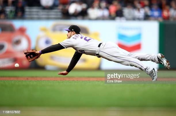 Nolan Arenado of the Colorado Rockies can not field a ground ball hit by Alex Dickerson of the San Francisco Giants in the first inning at Oracle...