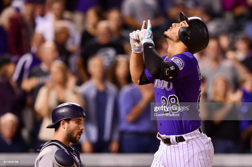 Nolan Arenado #28 of the Colorado Rockies celebrates after hitting an eighth inning solo homerun against the San Diego Padres at Coors Field on September 15, 2017 in Denver, Colorado.