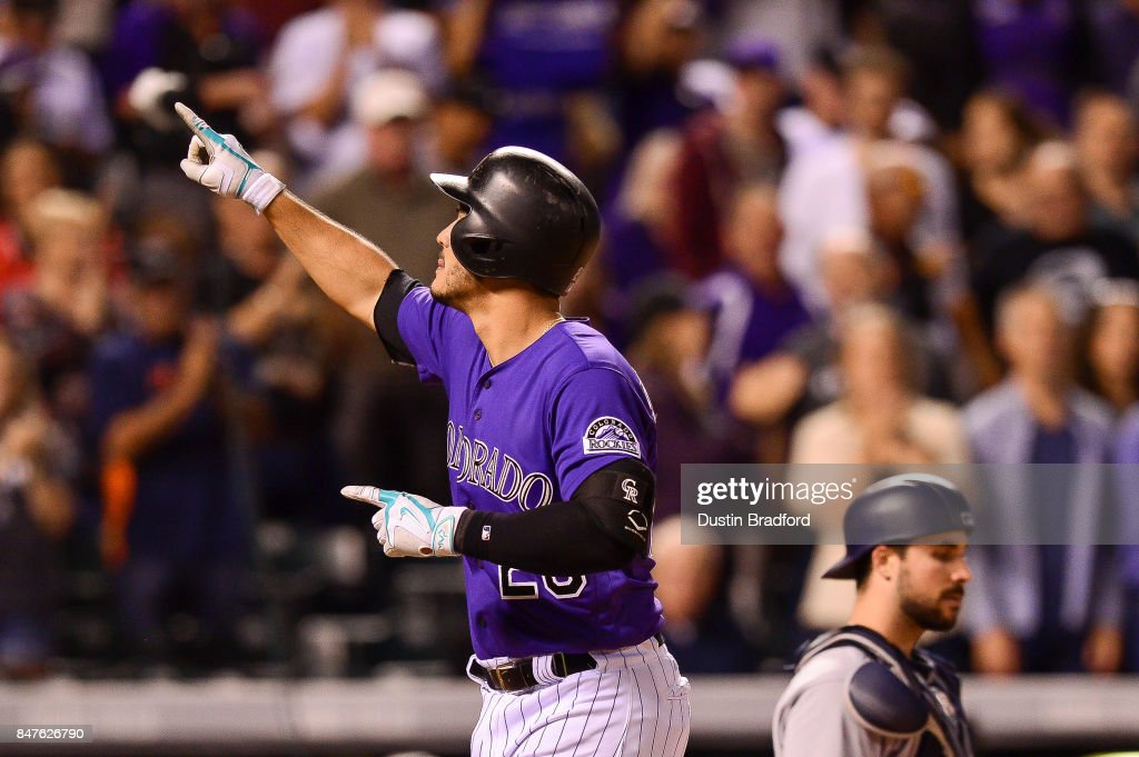 Nolan Arenado #28 of the Colorado Rockies celebrates and points towards a suite where members of the 2007 Colorado Rockies team were watching the game, after hitting an eighth inning solo homerun against the San Diego Padres at Coors Field on September 15, 2017 in Denver, Colorado.