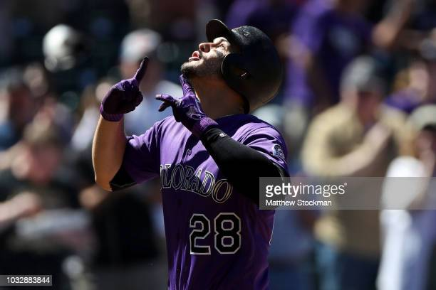 Nolan Arenado of the Colorado Rockies celebrates as he crosses the plate after hitting a home run in the first inning against the Arizona...