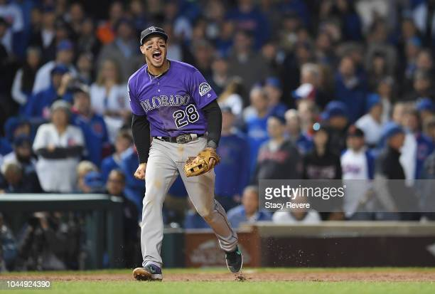 Nolan Arenado of the Colorado Rockies celebrates defeating the Chicago Cubs 2-1 in thirteen innings to win the National League Wild Card Game at...