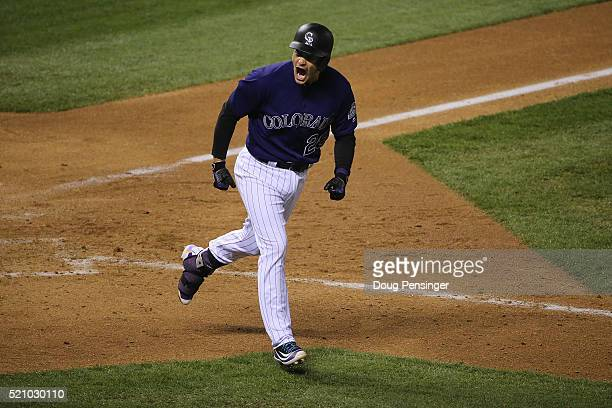 Nolan Arenado of the Colorado Rockies celebrates his three run home run off of Josh Osich of the San Francisco Giants in the eighth inning at Coors...