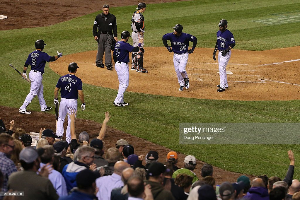 Nolan Arenado #28 of the Colorado Rockies celebrates his three run home run off of Josh Osich #61 of the San Francisco Giants in the eighth inning at Coors Field on April 13, 2016 in Denver, Colorado. Arenado had seven RBI's as the Rockies defeated the Giants 10-6.