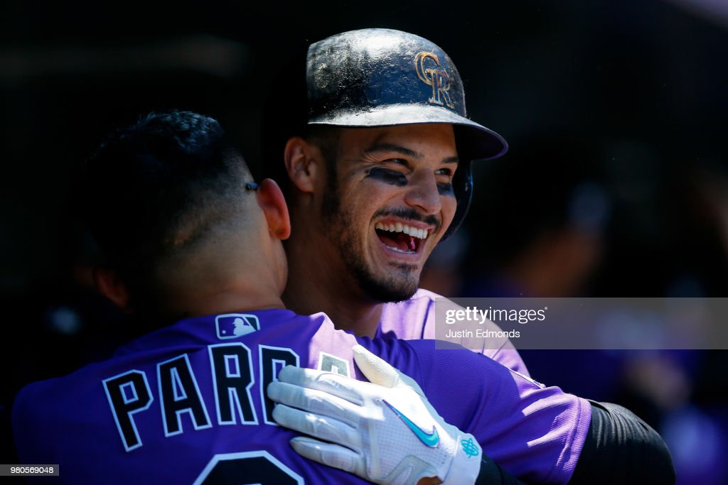 Nolan Arenado #28 of the Colorado Rockies celebrates his three-run home run with Gerardo Parra #8 during the first inning against the New York Mets at Coors Field on June 21, 2018 in Denver, Colorado.