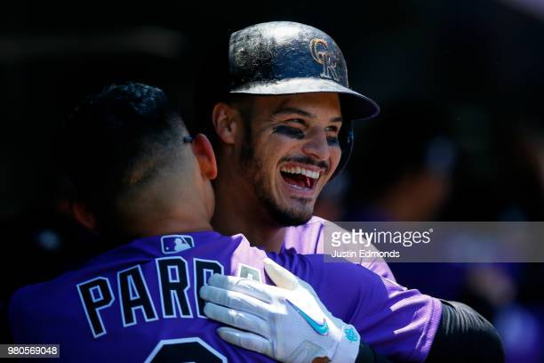 Nolan Arenado of the Colorado Rockies celebrates his threerun home run with Gerardo Parra during the first inning against the New York Mets at Coors...