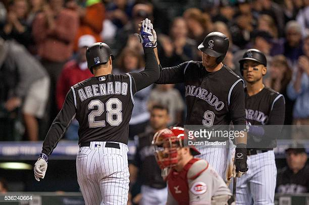 Nolan Arenado of the Colorado Rockies celebrates with DJ LeMahieu after hitting a sixth inning two run homerun his second of the game off of Daniel...