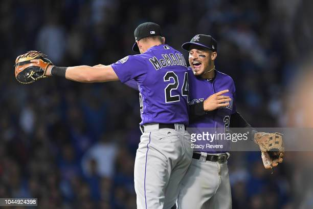 Nolan Arenado of the Colorado Rockies celebrates with Ryan McMahon after defeating the Chicago Cubs 21 in thirteen innings to win the National League...