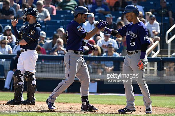 Nolan Arenado of the Colorado Rockies celebrates with teammate Carlos Gonzalez after hitting a two run homerun in the fourth inning against the...