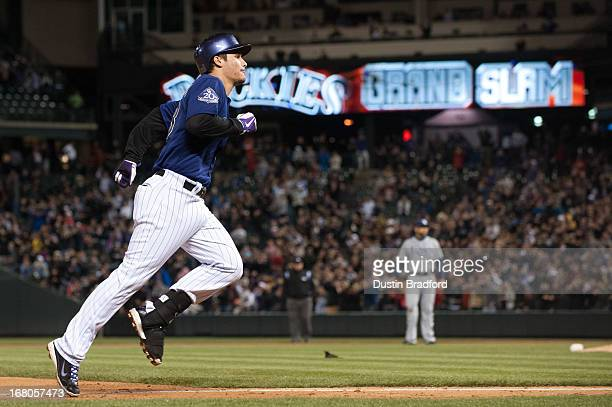 Nolan Arenado of the Colorado Rockies circles the bases after hitting a grand slam home run in the seventh inning of a game against the Tampa Bay...