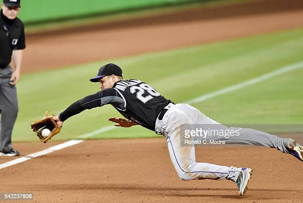 Nolan Arenado of the Colorado Rockies dives for a ball during a MLB game against the Miami Marlins at Marlins Park on June 20 2016 in Miami Florida