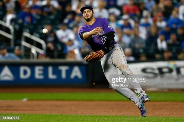 Nolan Arenado of the Colorado Rockies field sth eball for an out in the second inning against the New York Mets at Citi Field on July 14 2017 in the...