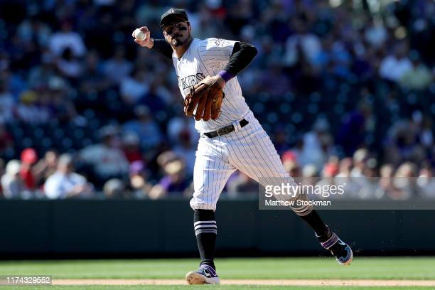 Nolan Arenado of the Colorado Rockies fields a ball hit by Jose Martinez of the St Louis Cardinals inning in the sixth inning at Coors Field on...