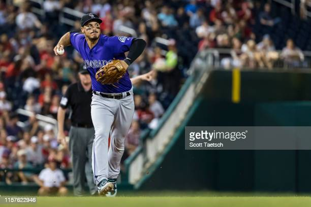 Nolan Arenado of the Colorado Rockies fields a ground ball against the Washington Nationals during the second inning of game two of a doubleheader at...