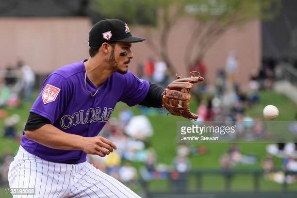 Nolan Arenado of the Colorado Rockies fields a ground ball during the spring training game against the Oakland Athletics at Salt River Fields at...
